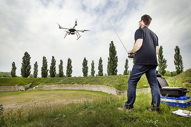 AUSTRIA / Burgenland/  Carnuntum; Gladiator School;  Geert Verhoeven (with remote control) starting up the md4-1000 microdrones quadcopter in the amphitheater of the Roman civil town in Carnuntum  © Reiner Riedler/ Anzenberger