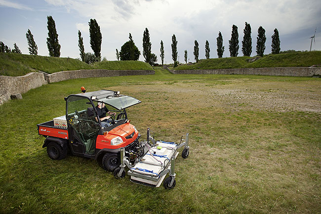 AUSTRIA / Burgenland/  Carnuntum; Gladiator School;  Klaus Löcker is archaeologist and researcher within the team of Programme Line 3 of the Ludwig Boltzmann Institute for Archaeological Prospection and Virtual Archaeology (LBI ArchPro), at an excavation site in Carnuntum. Here: LBI ArchPro's motorized ground penetrating radar array at the amphitheater of the Roman civil town in Carnuntum.  © Reiner Riedler/ Anzenberger