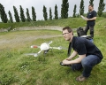 AUSTRIA / Burgenland/  Carnuntum; Gladiator School; Geert Verhoeven (with remote control) and Mario Wallner starting up the md4-1000 microdrones quadcopter in the amphitheater of the Roman civil town in Carnuntum  © Reiner Riedler/ Anzenberger