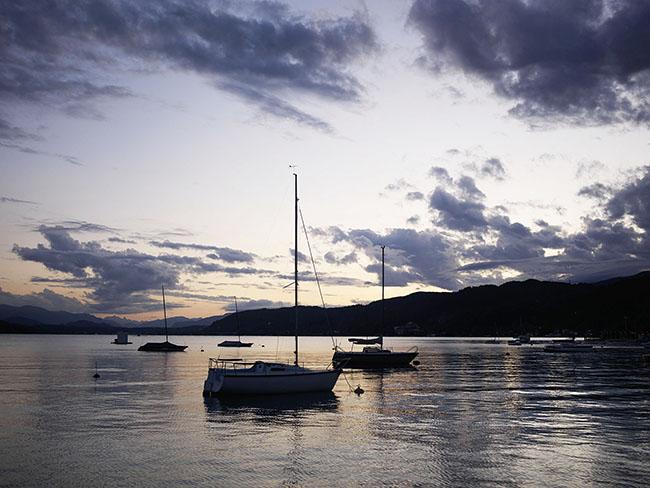 Austria; Carinthia; Wörthersee, Pörtschach, Boote in der Abendstimmung an der Promenade in Pörtschach ©  Reiner Riedler