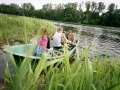 Latvia, Region Kurzeme (Kurland),Young people in boat on river Venta in Kuldiga  ©  Reiner Riedler / Anzenberger