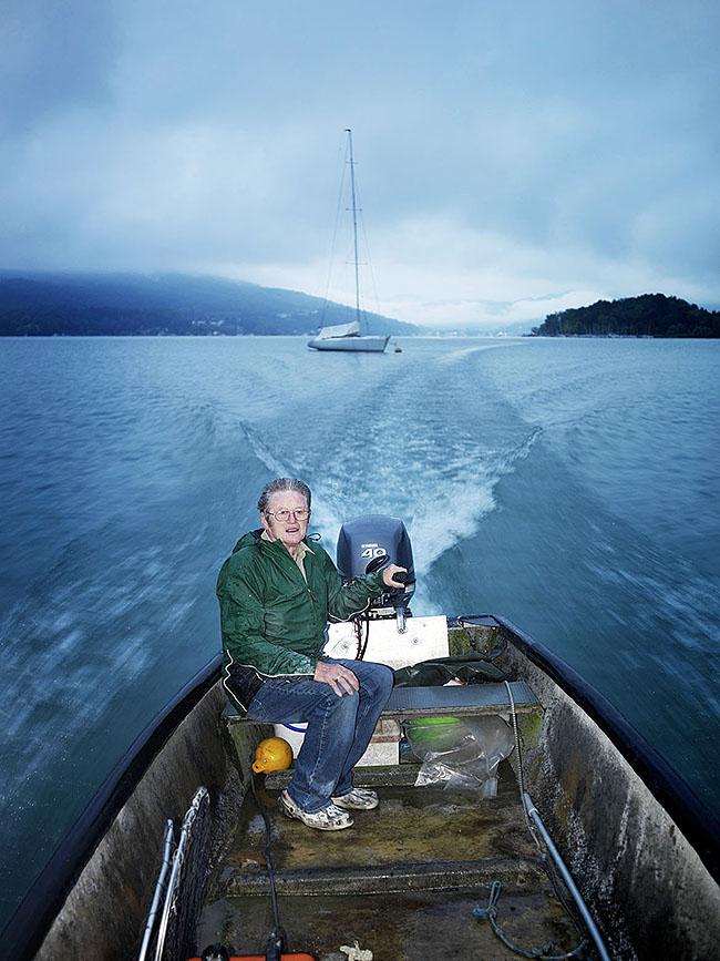 Austria; Carinthia; Wörthersee, Fischer Josef Huainig im Morgengrauen auf in seinem Boot auf dem See  ©  Reiner Riedler